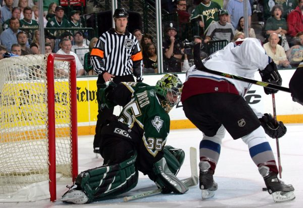 DALLAS - APRIL 30: Andrew Brunette #15 of the Colorado Avalanche scores the game winning goal against Marty Turco #35 of the Dallas Stars in overtime of game five of the Western Conference Quarterfinals of the 2006 NHL Playoffs on April 30, 2006 at the American Airlines Center in Dallas, Texas. The Avalanche defeated the Stars 3-2 in overtime to win the series 4-1. (Photo by Ronald Martinez/Getty Images)